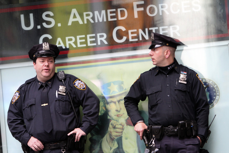 Photo - New York City police officers stand guard outside the Armed Forces recruitment center in New York's Times Square,  Monday, May 2, 2011. The Obama administration used DNA testing and other means to confirm that elite American forces in Pakistan had in fact killed Osama bin Laden, the mastermind behind the Sept. 11, 2001 terrorist attacks, officials said Monday. (AP Photo/Mary Altaffer) ORG XMIT: NYMA107