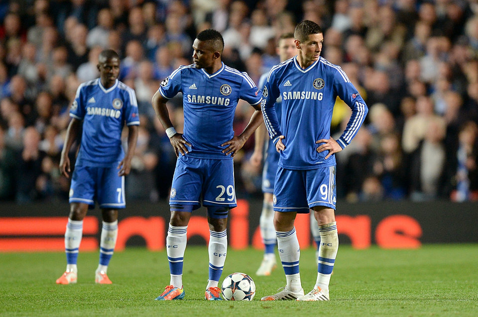 Photo - Chelsea's Fernando Torres, right, and Samuel Eto'o, center, stand dejected after conceding a second goal during the Champions League semifinal second leg soccer match between Chelsea and Atletico Madrid at Stamford Bridge stadium in London, Wednesday, April 30, 2014. (AP Photo/Andrew Matthews, PA Wire)    UNITED KINGDOM OUT    -   NO SALES   -   NO ARCHIVES