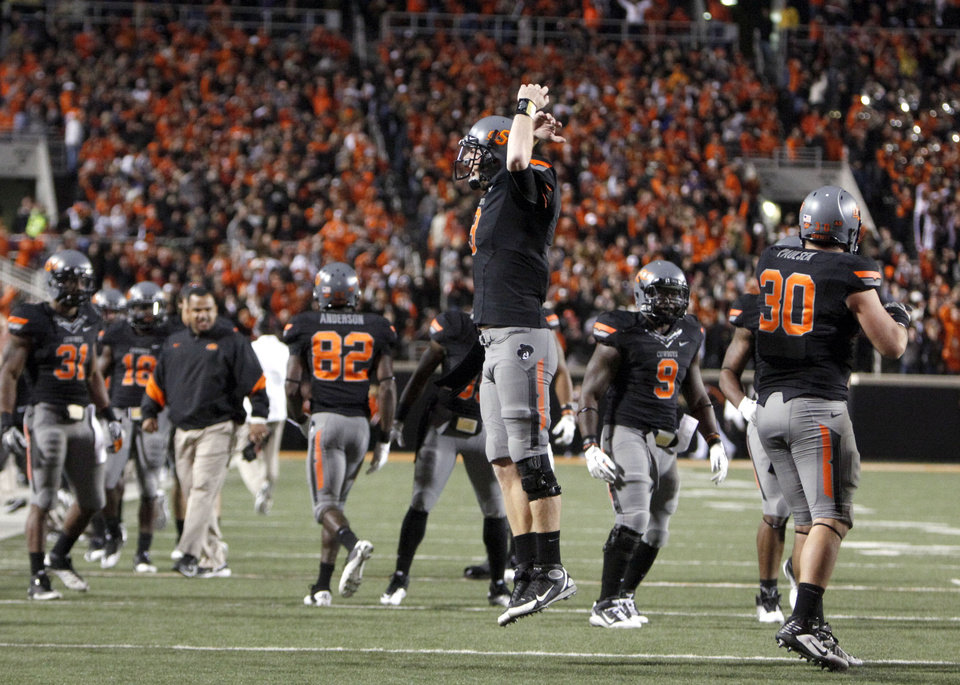 Oklahoma State's Brandon Weeden (3) celebrates Joseph Randle's winning touchdown during a college football game between the Oklahoma State University Cowboys (OSU) and the Kansas State University Wildcats (KSU) at Boone Pickens Stadium in Stillwater, Okla., Saturday, Nov. 5, 2011.  Photo by Sarah Phipps, The Oklahoman ORG XMIT: KOD