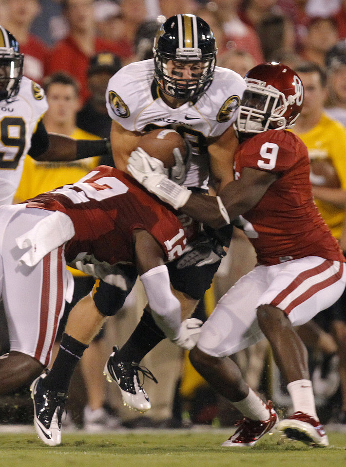 Photo - Oklahoma's Gabe Lynn (9) and Javon Harris (12) stop Missouri's T.J. Moe (28) during their game Saturday in Norman.Photo by Chris Landsberger, The Oklahoman