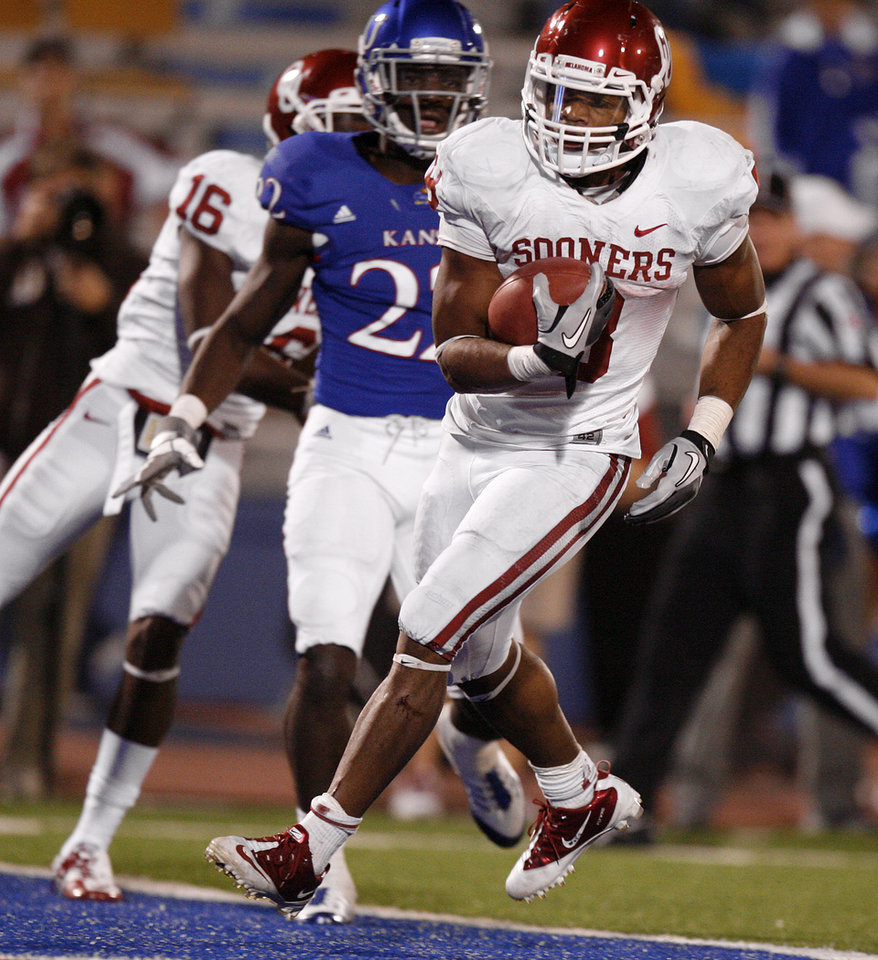 Photo - Oklahoma's Dominique Whaley (8) scores a touchdown during the college football game between the University of Oklahoma Sooners (OU) and the University of Kansas Jayhawks (KU) at Memorial Stadium in Lawrence, Kansas, Saturday, Oct. 15, 2011. Photo by Bryan Terry, The Oklahoman