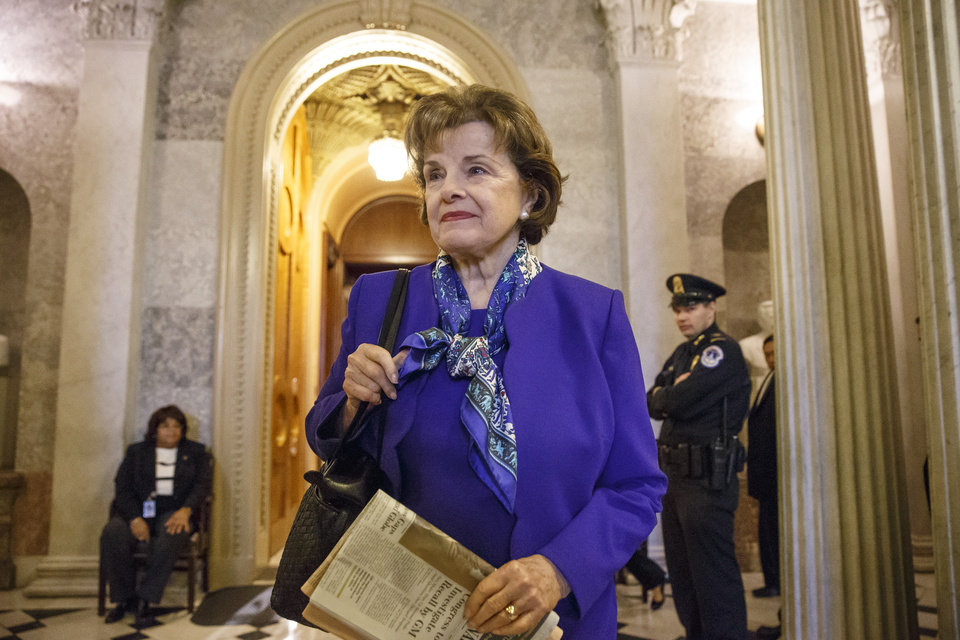 Photo - Senate Intelligence Committee Chair Sen. Dianne Feinstein, D-Calif. leaves the Senate chamber on Capitol Hill in Washington, Tuesday, March 11, 2014, after saying that the CIA's improper search of a stand-alone computer network established for Congress has been referred to the Justice Department. The issue stems from the investigation into allegations of CIA abuse in a Bush-era detention and interrogation program. (AP Photo/J. Scott Applewhite)