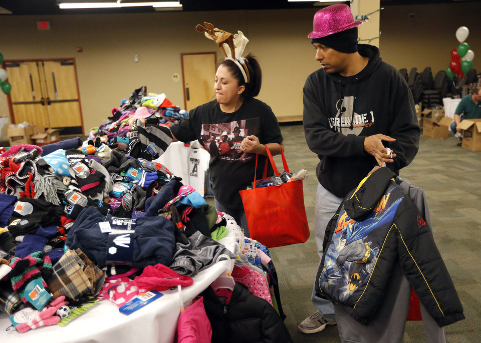 U.S. Air Force Tech Sgt. Steve Monje and Jessica Monje shop for Christmas gifts Tuesday at Operation Homefront distribution center at the Reed Center in Midwest City.