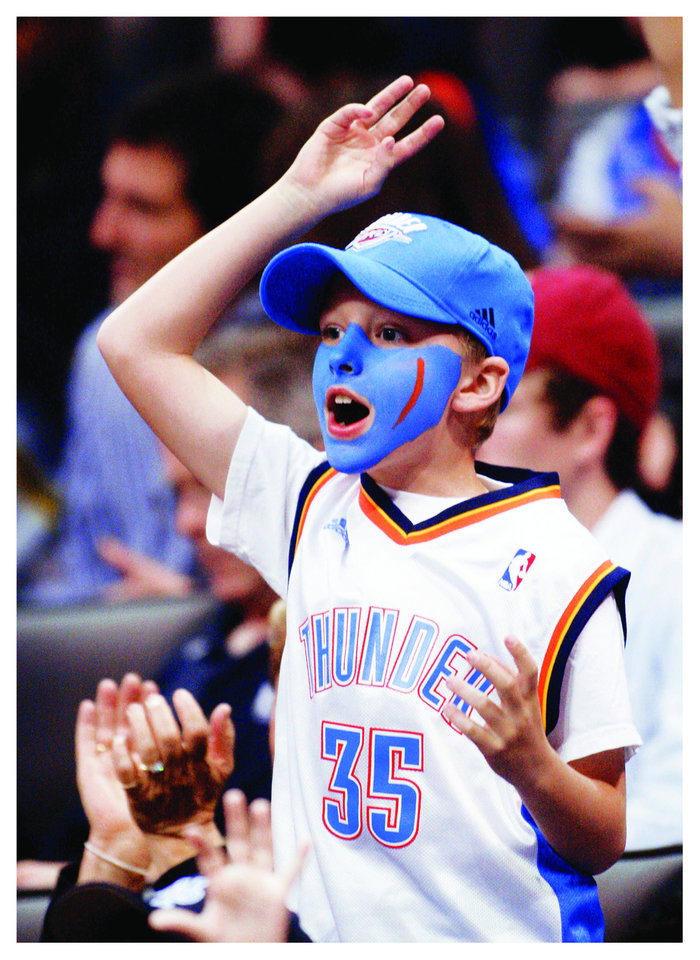 Photo - A fan cheers during a game in March. AP PHOTO