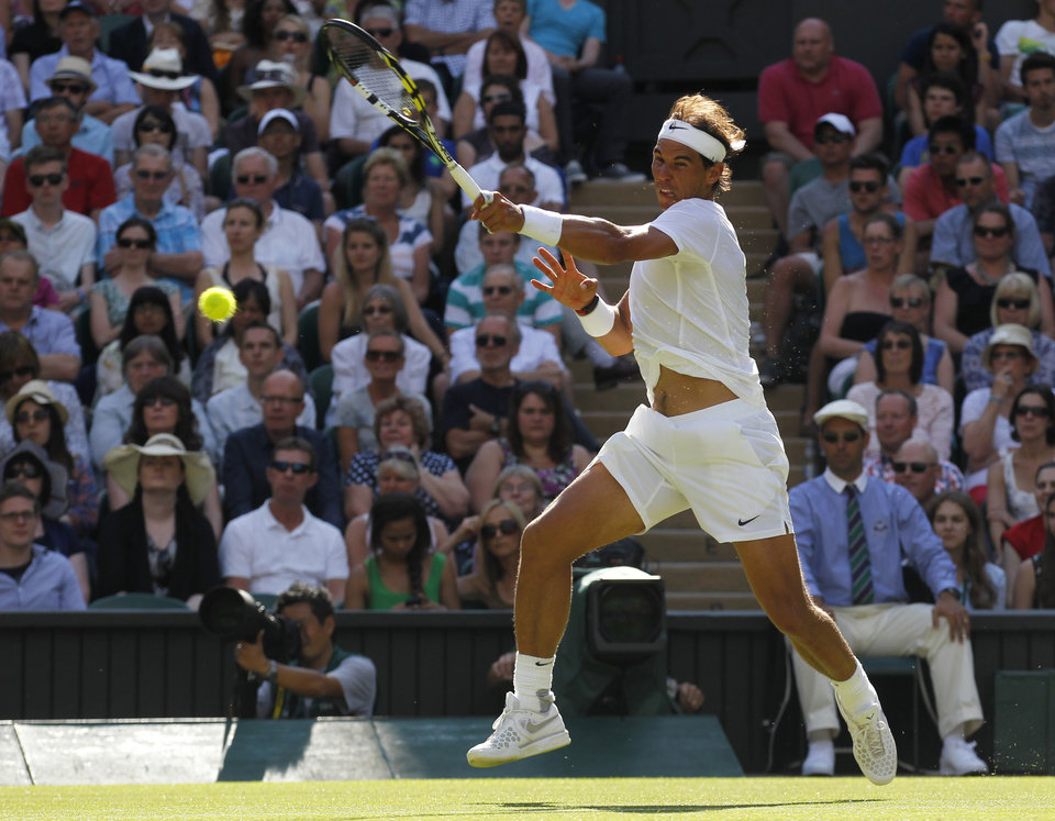 Photo - Rafael Nadal of Spain plays a return to Martin Klizan of Slovakia during their match at the All England Lawn Tennis Championships in Wimbledon, London, Tuesday, June 24, 2014. (AP Photo/Sang Tan)
