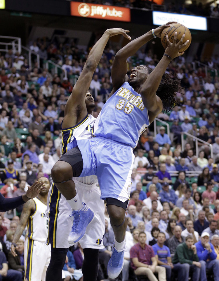 Denver Nuggets' Kenneth Faried (35) goes to the basket as Utah Jazz's Derrick Favors, rear, defends in the first quarter during an NBA basketball game on Wednesday, April 3, 2013, in Salt Lake City. (AP Photo/Rick Bowmer)
