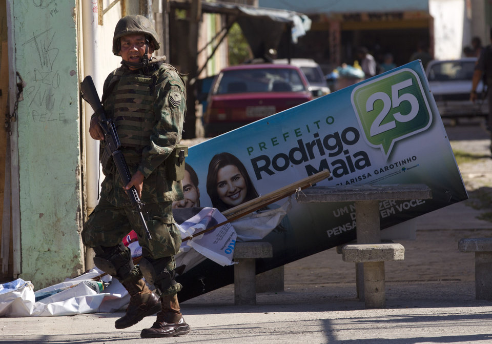 In this Oct. 1, 2012 photo, a soldier patrols ahead of municipal elections in the Fogo Cruzado slum of Rio de Janeiro, Brazil. Brazil will hold nationwide municipal elections on Sunday, Oct. 7. (AP Photo/Silvia Izquierdo)