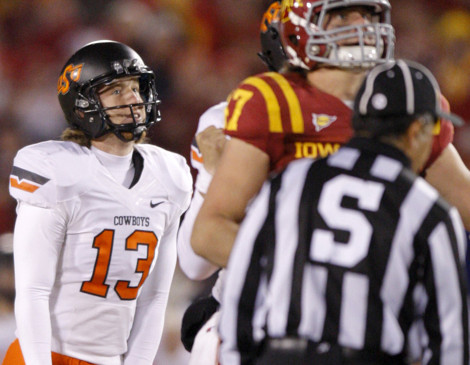 Photo - Oklahoma State's Quinn Sharp (13) looks up after missing a field goal in the final minutes of a college football game between the Oklahoma State University Cowboys (OSU) and the Iowa State University Cyclones (ISU) at Jack Trice Stadium in Ames, Iowa, Friday, Nov. 18, 2011. Photo by Bryan Terry, The Oklahoman