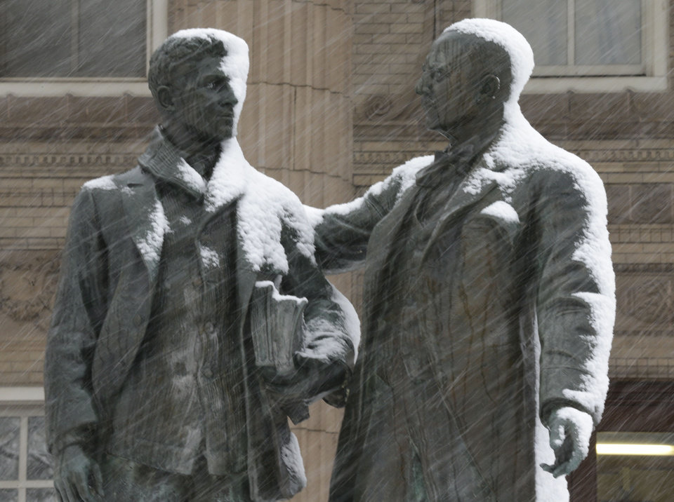 Photo - Snow begins to gathers on a statue on the University of Kansas campus in Lawrence, Kan., Saturday, March 23, 2013. The area is under a winter storm warning. (AP Photo/Orlin Wagner)