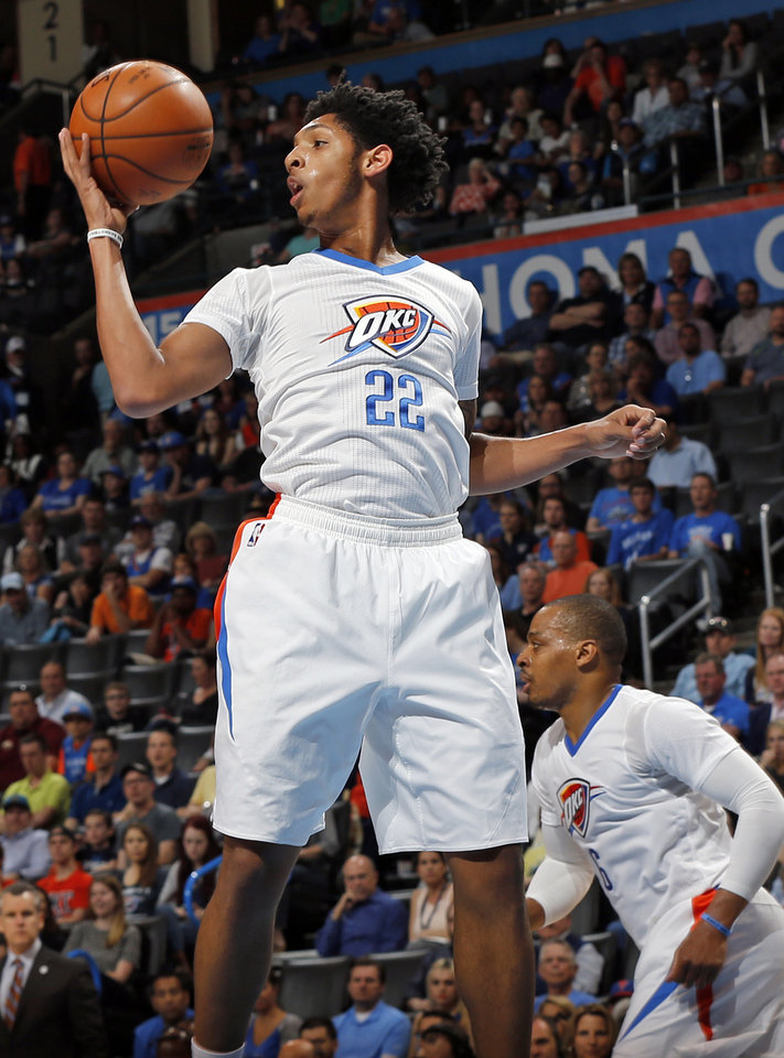 Photo - Oklahoma City's Cameron Payne (22) grabs a rebound next to Randy Foye (6) during an NBA basketball game between the Oklahoma City Thunder and the Portland Trailblazers at the Chesapeake Energy Arena in Oklahoma City, Monday, March 14, 2016. Oklahoma City won 128-94. Photo by Nate Billings, The Oklahoman