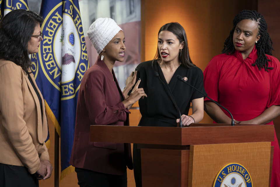 "Photo - From left, Rep. Rashida Tlaib, D-Mich., Rep. Ilhan Omar, D-Minn., Rep. Alexandria Ocasio-Cortez, D-N.Y., and Rep. Ayanna Pressley, D-Mass., respond to remarks by President Donald Trump after his call for the four Democratic congresswomen to go back to their ""broken"" countries, during a news conference at the Capitol in Washington, Monday, July 15, 2019. All are American citizens and three of the four were born in the U.S. [AP Photo/J. Scott Applewhite]"