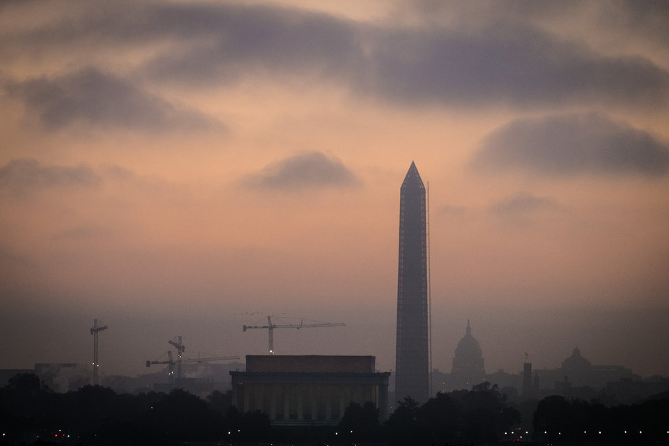 Photo - Low clouds and fog roll across Washington at sunrise Tuesday, Oct. 15, 2013 as Congress continues to negotiate their way free from the budget standoff that has shutdown many part of the U.S. government for 15 days. (AP Photo/J. David Ake)