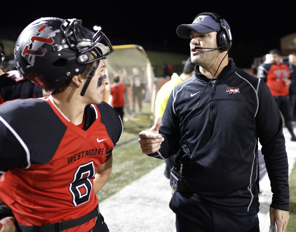 Photo - WM coach Billy Langford talks with player #6 Austin Dodd during the high school football game between Broken Arrow and Westmoore at Moore stadium Friday , November 8, 2013. Photo by Doug Hoke, The Oklahoman