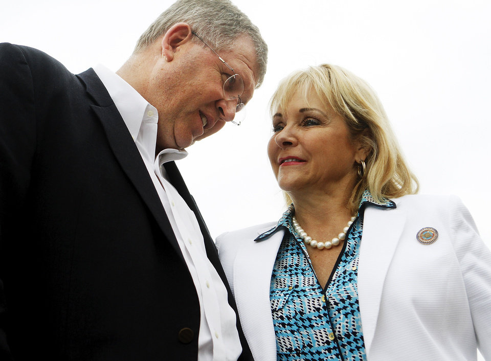 Photo -  U.S. Rep. Frank Lucas and Gov. Mary Fallin speak to one another during the watershed program's announcement ceremony. Photo by K.T. King, The Oklahoman   KT King -