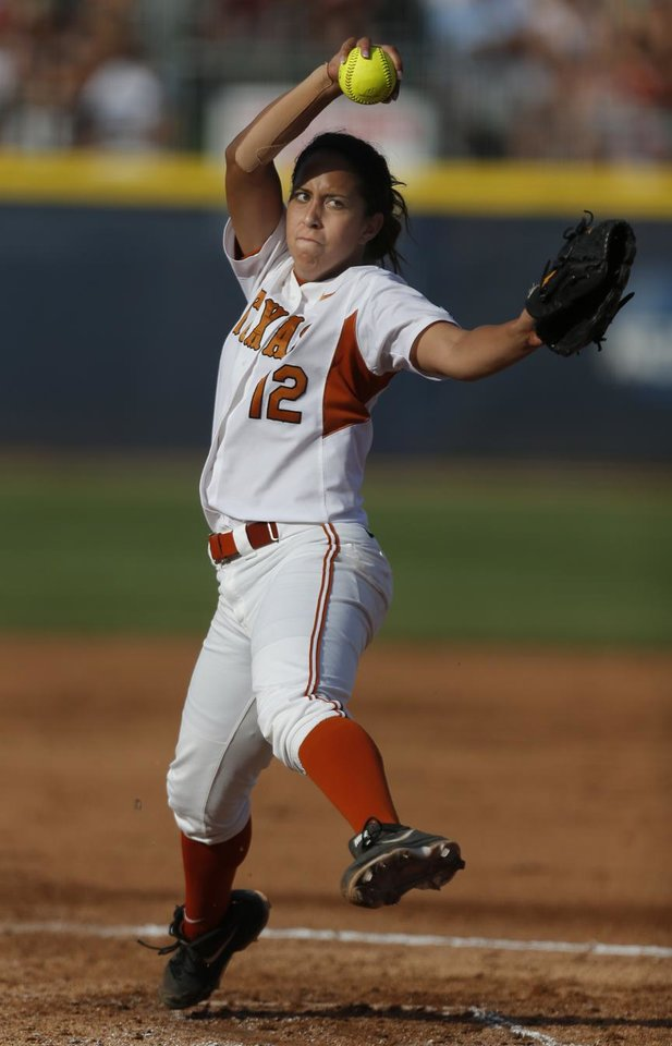 Photo - Texas' Blaire Luna throws a pitch during Women's College World Series softball game at ASA Hall of Fame Stadium in Oklahoma City, Sunday, June, 2, 2013. Photo by Sarah Phipps, The Oklahoman Download
