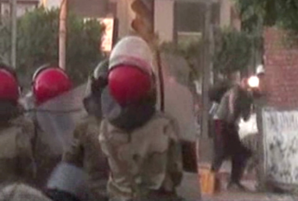 Photo - This image made from video released by the Egyptian military on Monday, July 8, 2013, which is consistent with other AP reporting, purports to show a muzzle flash, at right, as Egyptian Army troops stand at left during a confrontation with supporters of ousted President Mohammed Morsi that resulted in the deaths of 51 people in Cairo, Egypt. The shootings began during a protest by about 1,000 Islamists outside the Republican Guard headquarters where Morsi, Egypt's first freely elected leader, was detained last week. Demonstrators and members of the Brotherhood said troops descended on them and opened fire unprovoked as they finished dawn prayers. (AP Photo/Egyptian Military via AP video)