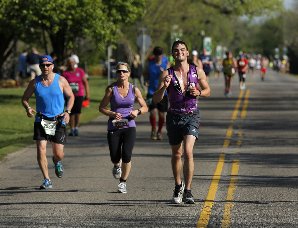 Photo - Runners make their way south on Classen near NW 63rd St. during the Oklahoma City Memorial Marathon in Oklahoma City, Sunday, April 28, 2013.  Photo by Garett Fisbeck, For The Oklahoman