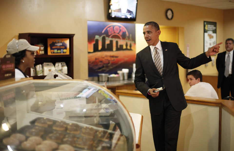 Photo -   President Barack Obama makes an order during unannounced visit to Krispy Kreme Doughnuts, Thursday, Oct. 25, 2012, in Tampa, Fla. Obama, who traveled to Florida for a campaign event nearby, surprised local patrons when he drove up in the morning. (AP Photo/Pablo Martinez Monsivais)