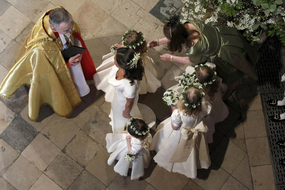 Photo - Maid of Honour Pippa Middleton, centre, the sister of Kate Middleton, and bridesmaids speak to Stephen Lamport, left, Receiver General of Westminster Abbey, inside the Abbey before the wedding of Britain's Prince William and Kate Middleton in London, Friday April 29, 2011. (AP Photo/Suzanne Plunkett, Pool)  ORG XMIT: RWDJ120