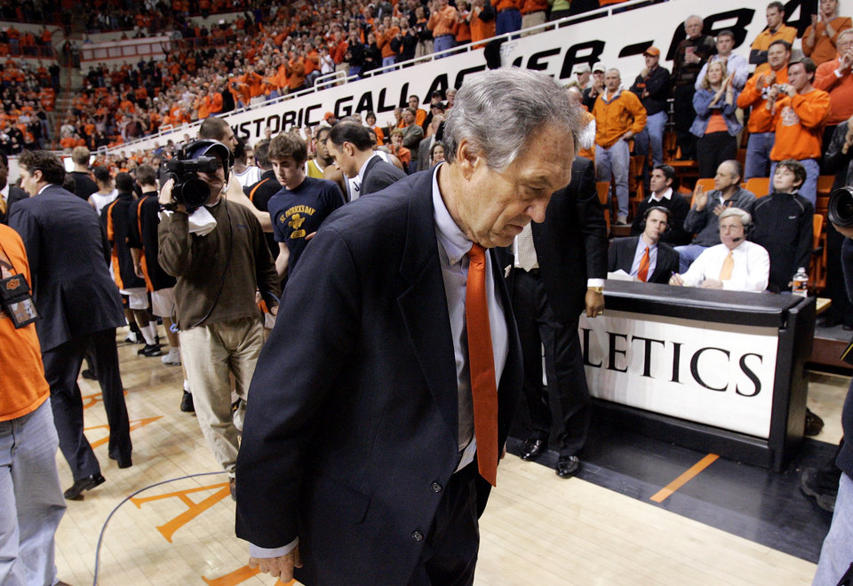 Photo - Stillwater, Okla. - January 11, 2005. Oklahoma State University Cowboys (OSU) vs. University of Missouri (MIZZOU) Tigers men's college basketball in Gallagher-Iba Arena. OSU head coach Eddie Sutton leaves the floor after beating Missouri and getting his 767th victory, tying his mentor Henry Iba for number of career victories. By Nate Billings/The Oklahoman
