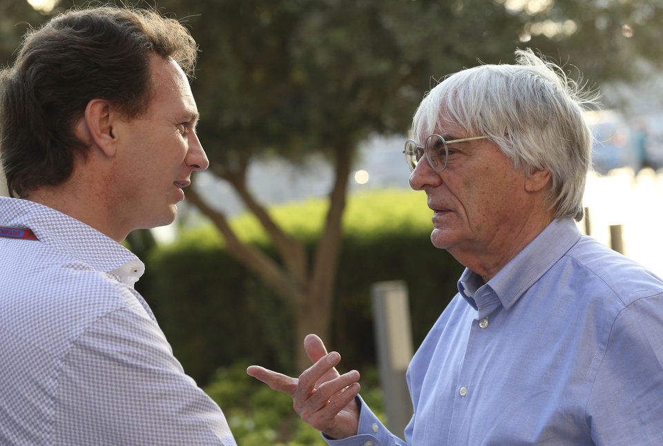 Photo - FILE - In this Thursday, Nov. 1, 2012 file photo, Red Bull team principal Christian Horner, left, talks with Bernie Ecclestone, president and CEO of Formula One Management, at the Yas Marina racetrack in Abu Dhabi, United Arab Emirates. With Ecclestone's Formula One future in doubt amid bribery allegations, one of the most influential team bosses on Wednesday, Jan. 15, 2014 said the series' prosperity relies on him remaining in charge. Christian Horner, team principal of reigning constructors' champion Red Bull, believes Ecclestone is