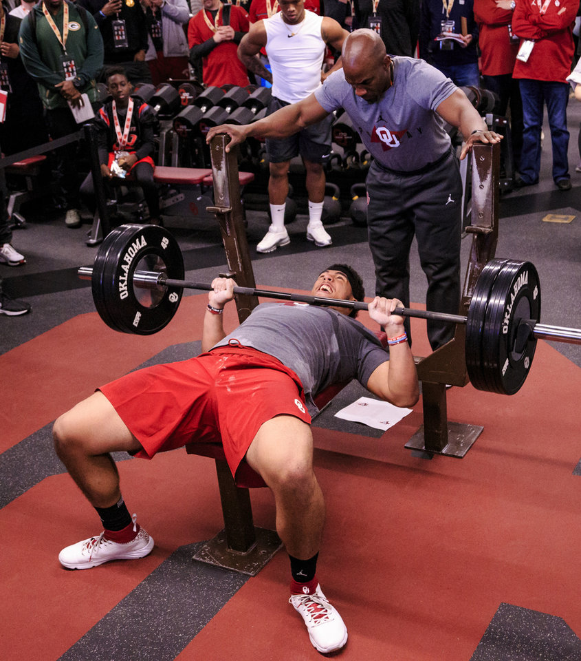 Photo - Amani Bledsoe does the bench press as he works out for NFL scouts during the University of Oklahoma football pro day at the University of Oklahoma in Norman, Okla. on Wednesday, March 13, 2019.   Photo by Chris Landsberger, The Oklahoman