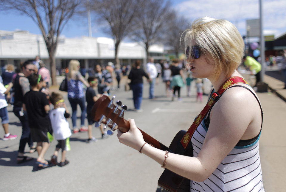 Photo - UCO@ACM grad Mackenzie Pulse performs  at Open Streets OKC, along NW 23rd Street between Robinson and Western, Sunday, March 22, 2015. Photo by Doug Hoke, The Oklahoman
