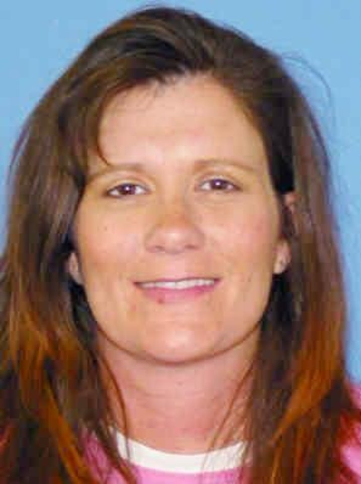 Photo - MISSING FAMILY: Sherrilynn Jamison, 40, of Eufaula, along with her husband and daughter, was last seen Oct. 8, 2009. Authorities found her husband's pickup in a rural area of Latimer County several days later, but not the family. Provided by Latimer County Sheriff's Office. ORG XMIT: KOD
