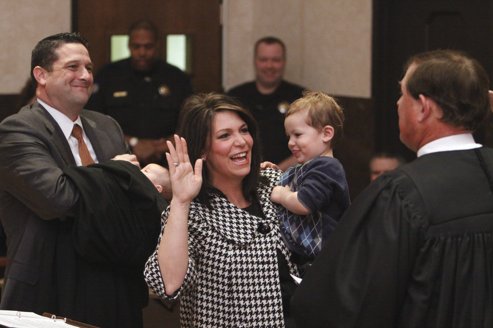 State Court of Criminal Appeals Judge William C. Hetherington Jr. swears in new district judge Tracy Schumacher on Thursday, February 24, 2011, in Norman, Okla. Schumacher\'s husband Wade Stewart, son Jacob and new daughter Reagan attended the ceremony. Photo by Steve Sisney, The Oklahoman