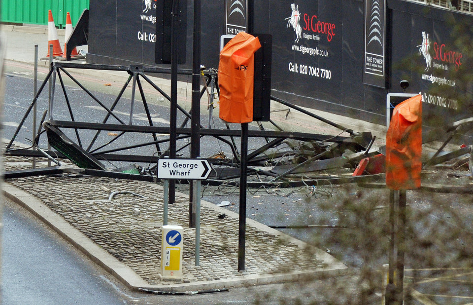 Photo - A section of a damaged crane lays on the ground after a helicopter crashed into the crane on top of a building in central London, Wednesday Jan. 16, 2013. Police say two people were killed when a helicopter crashed Wednesday during rush hour in central London after apparently hitting a construction crane on top of a building. (AP Photo/PA, John Stillwell) UNITED KINGDOM OUT  NO SALES  NO ARCHIVE