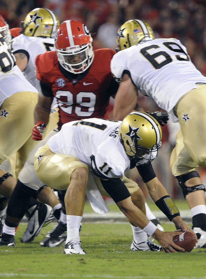 Photo -   Vanderbilt quarterback Jordan Rodgers (11) scrambles to recover a fumble in the backfield as Georgia linebacker Jarvis Jones (29) pursues during the first half of an NCAA college football game on Saturday, Sept. 22, 2012, in Athens, Ga. (AP photo/John Amis)