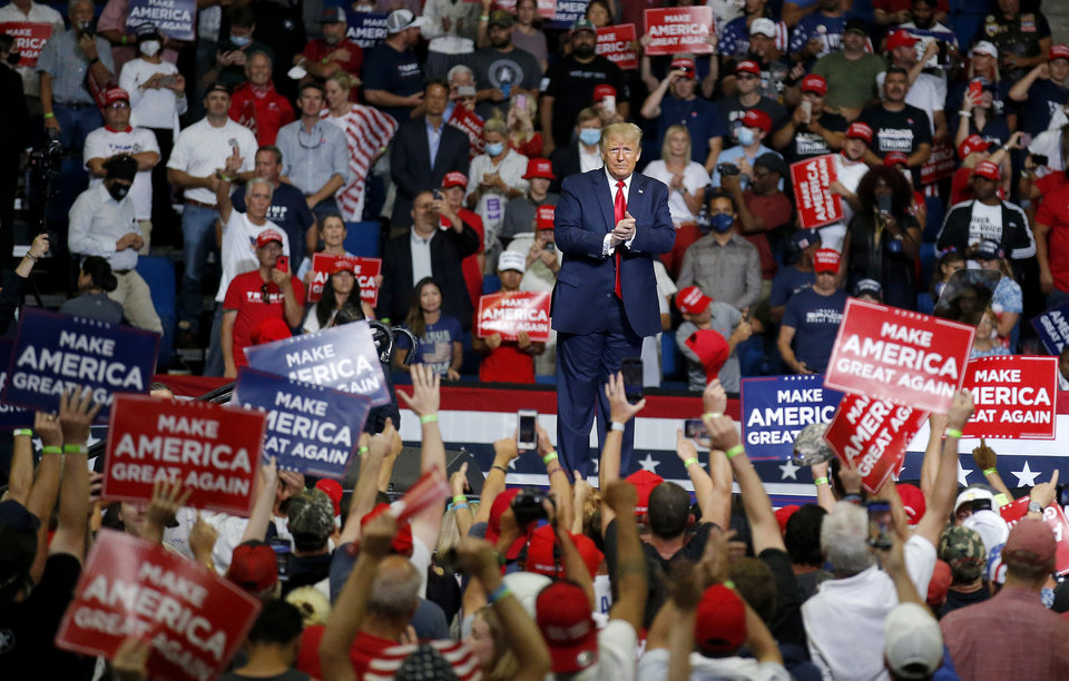 Photo - President Donald Trump acknowledges supporters after his speech during a rally at the BOK Center in Tulsa, Okla., Saturday, June 20, 2020. [Sarah Phipps/The Oklahoman]