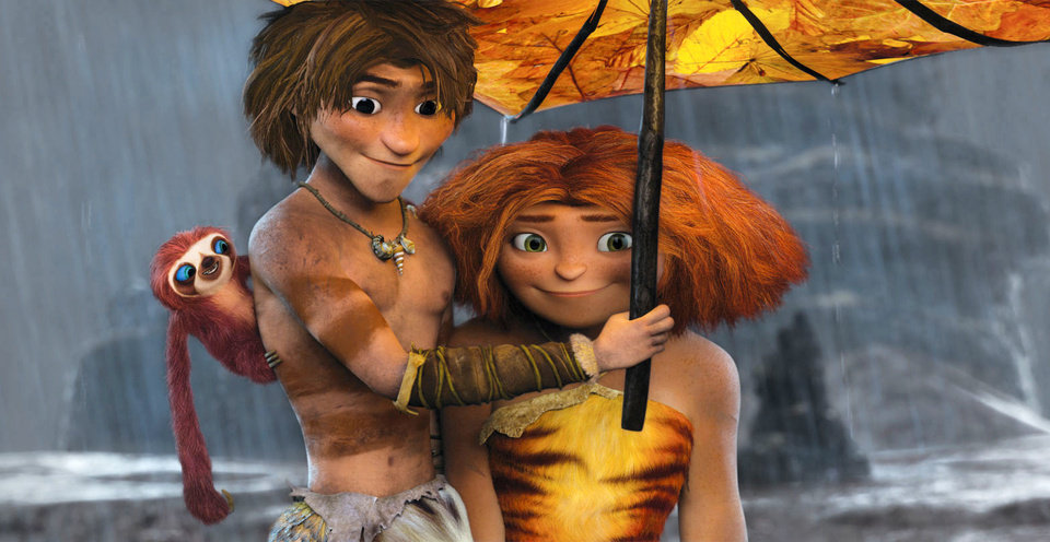 This film publicity image released by DreamWorks Animation shows, from left, Belt the sloth, voiced by Chris Sanders, Guy, voiced by Ryan Reynolds, and Eep, voiced by Emma Stone, in a scene from