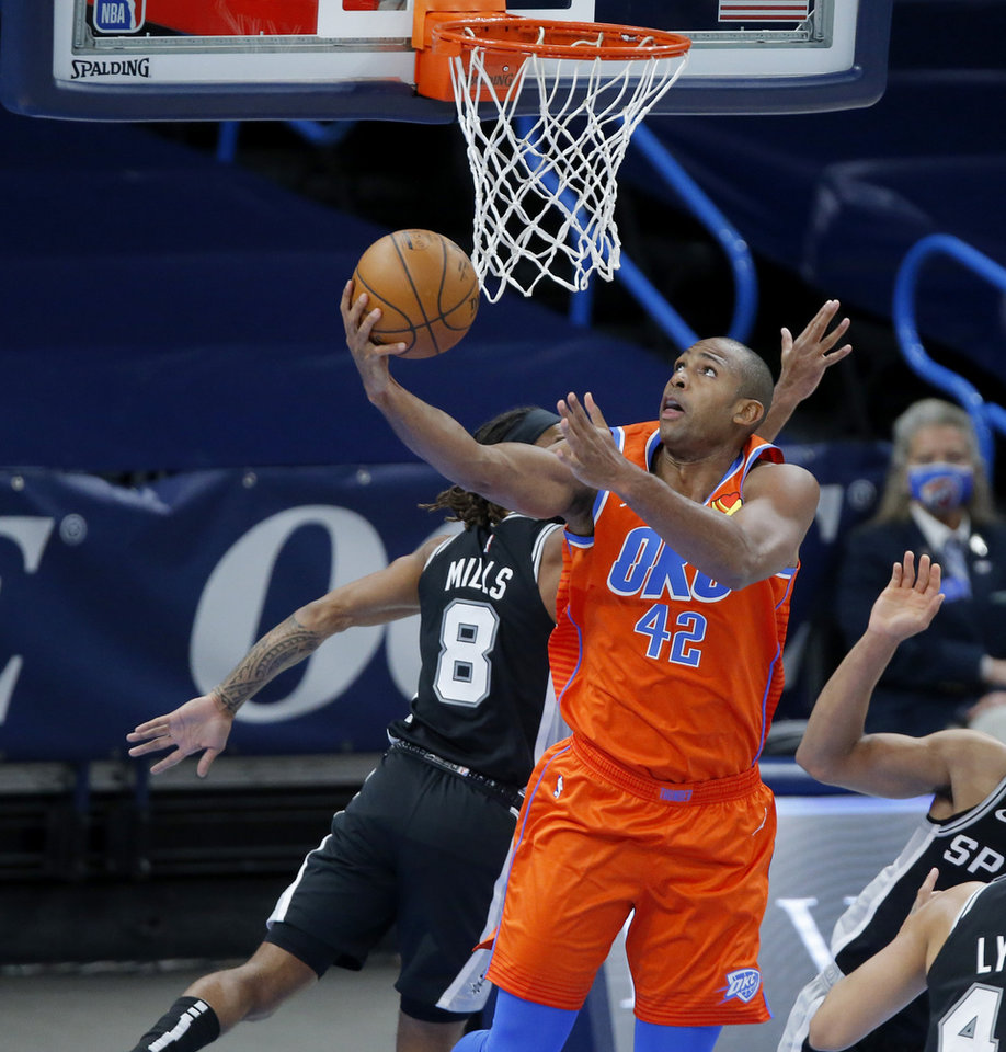 Photo - Oklahoma City's Al Horford (42) goes to the basket during an NBA basketball game between the Oklahoma City Thunder and the San Antonio Spurs at Chesapeake Energy Arena in Oklahoma City, Tuesday, Jan. 12, 2021. [Bryan Terry/The Oklahoman]