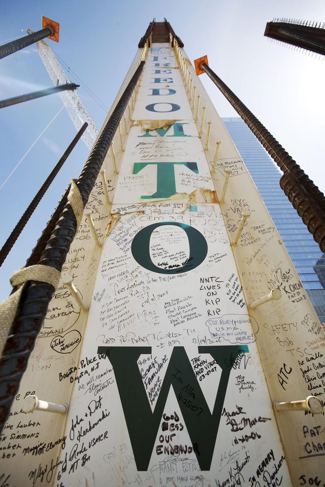 Photo - FILE- In this May 30, 2007 file photo, a steel column for the Freedom Tower bears signatures of Sept. 11 victims' family members at the World Trade Center in New York. Their signatures join those left by some who worked on the towers. Construction workers have left personal messages on One World Trade Center in the form of graffiti. (AP Photo/Mark Lennihan, File)