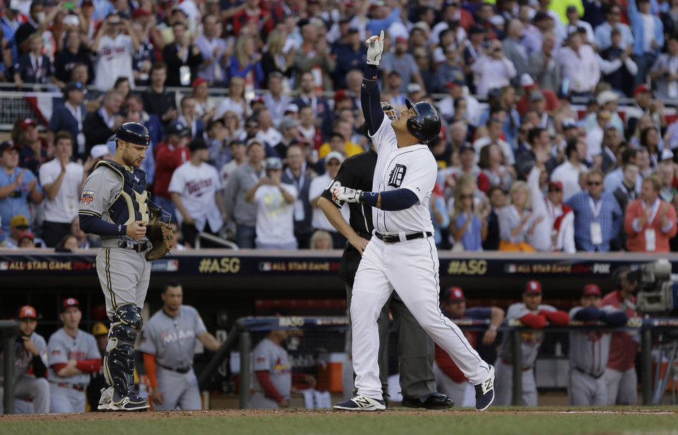 Photo - Miguel Cabrera, of the Detroit Tigers, celebrates after hitting a home run during the first inning of the MLB All-Star baseball game, Tuesday, July 15, 2014, in Minneapolis. (AP Photo/Jeff Roberson)