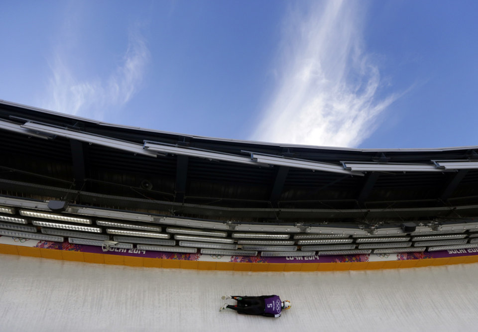 Photo - Sean Greenwood of Ireland speeds down the track during the men's skeleton training at the 2014 Winter Olympics, Wednesday, Feb. 12, 2014, in Krasnaya Polyana, Russia. (AP Photo/Natacha Pisarenko)