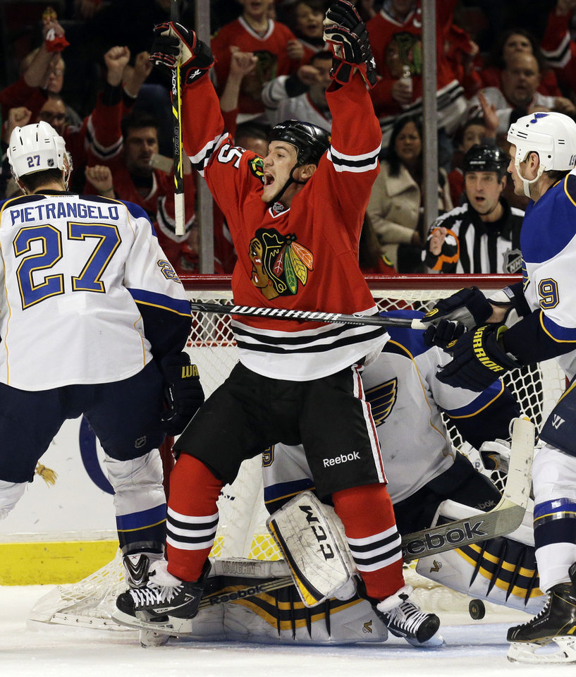Photo - Chicago Blackhawks' Andrew Shaw (65) celebrates after scoring a goal during the second period in Game 4 of a first-round NHL hockey playoff series against the St. Louis Blues in Chicago, Wednesday, April 23, 2014. (AP Photo/Nam Y. Huh)