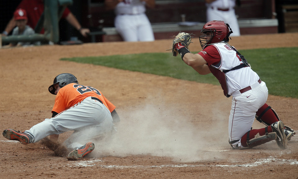 Photo - Oklahoma's Anthony Hermelyn tags out Oklahoma State's Zach Fish during the Bedlam baseball game between the University of Oklahoma and Oklahoma State University at the Chickasaw Bricktown Ballpark in Oklahoma CIty, Sunday, May 12, 2013. Photo by Sarah Phipps, The Oklahoman