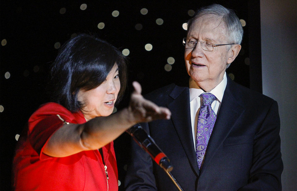 Photo - In this photo taken on Thursday, Aug. 21, 2014, U.S. Rep. Grace Meng, D-Queens,  and U.S. Sen. Harry Reid, D-Nev., take the stage during the Asian Chamber of Commerce's monthly lunch at the Gold Coast casino-hotel in Las Vegas. Reid, the Democratic Senate Majority Leader, apologized Friday, for jokes he made about Asians during the luncheon. (AP Photo/Las Vegas Review-Journal, Erik Verduzco) LAS VEGAS SUN OUT