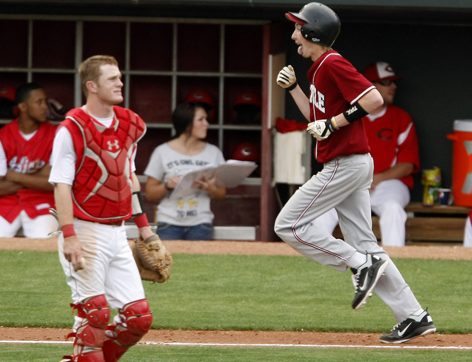 Tuttle's Dillon Cornelson celebrates as he runs home past Comanche's Kale Reed in the fifth inning of their high school baseball game at RedHawks Field at Bricktown in Oklahoma City, Tuesday, March 27, 2012. Photo by Bryan Terry