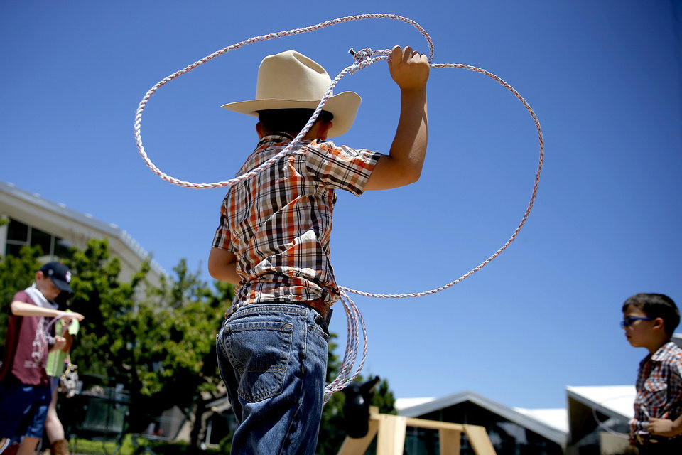 Photo -  Alejandro Escobar, 7, throws his rope during the Chuck Wagon Festival at the National Cowboy & Western Heritage Museum in Oklahoma City, Saturday, May 26, 2018. [Bryan Terry/The Oklahoman]