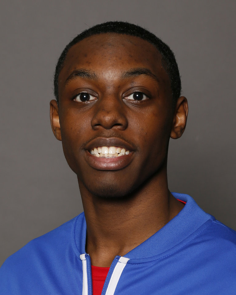Photo - Malik Foxx, John Marshall boys basketball player, poses for a photo during winter high school sports photo day in Oklahoma City, Wednesday, Nov. 20, 2013. Photo by Nate Billings, The Oklahoman