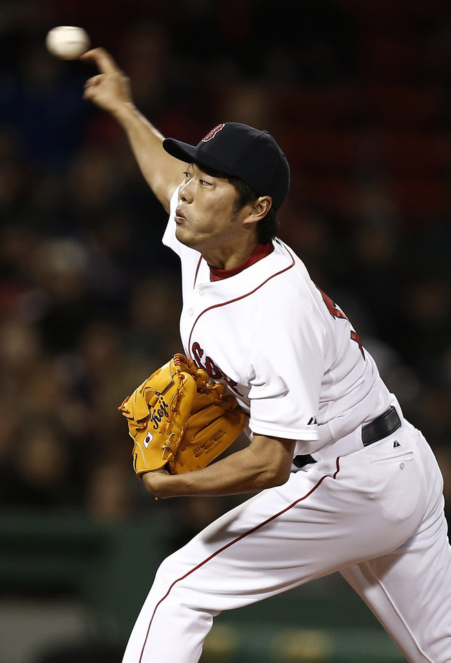 Boston Red Sox relief pitcher Koji Uehara, of Japan, delivers against the Baltimore Orioles during the seventh inning of a baseball game at Fenway Park in Boston, Thursday, April 11, 2013. (AP Photo/Winslow Townson)