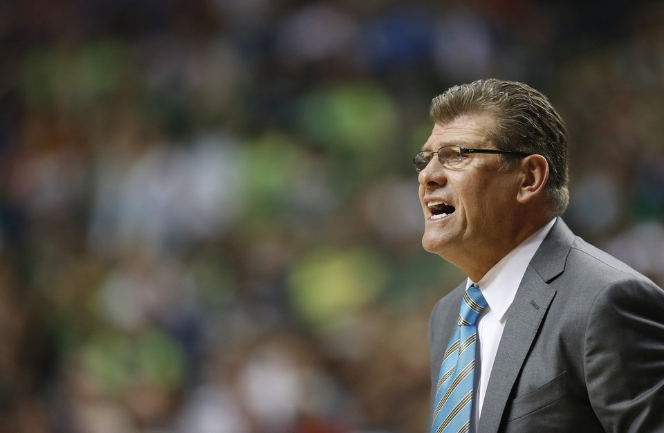 Photo - Connecticut head coach Geno Auriemma works against Notre Dame during the first half of the championship game in the Final Four of the NCAA women's college basketball tournament, Tuesday, April 8, 2014, in Nashville, Tenn. (AP Photo/John Bazemore)