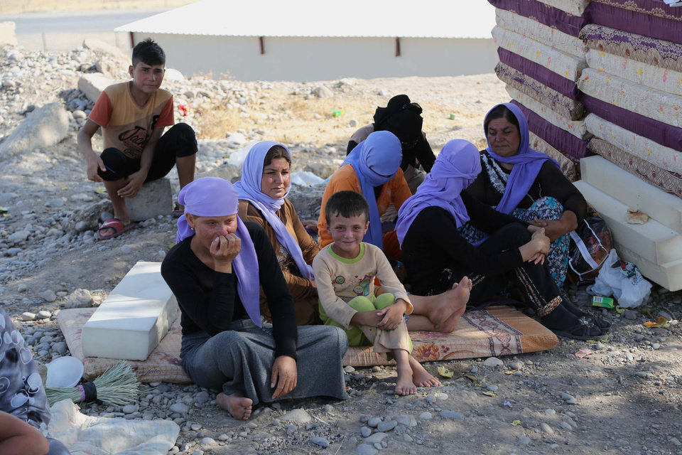 Photo - Displaced Iraqis from the Yazidi community settle at the Qandil mountains near the Turkish border outside Zakho, 300 miles (475 kilometers) northwest of Baghdad, Iraq, Saturday, Aug. 16, 2014. Islamic extremists shot 80 Yazidi men to death in Iraq, lining them up in small groups and opening fire with assault rifles before abducting their wives and children, officials and eyewitnesses reported Saturday. (AP Photo/ Khalid Mohammed)