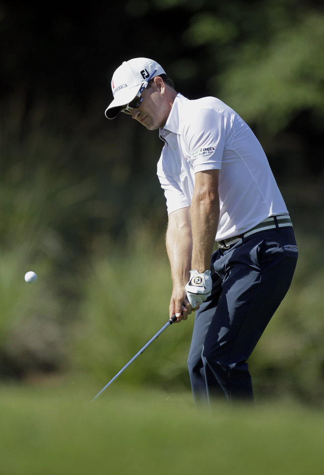 Photo -   Zach Johnson chips onto the seventh green during the second round of the Players Championship golf tournament at TPC Sawgrass, Friday, May 11, 2012, in Ponte Vedra Beach, Fla. (AP Photo/John Raoux)