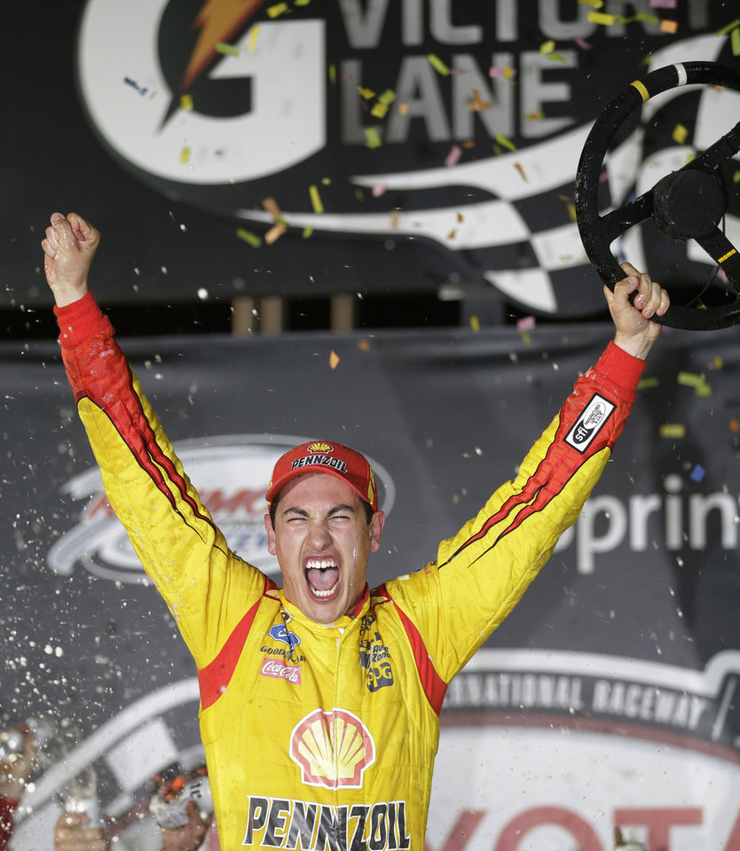 Photo - Joey Logano celebrates his win in the NASCAR Sprint Cup auto race at Richmond International Raceway in Richmond, VA., Saturday, April 26, 2014. (AP Photo/Steve Helber)