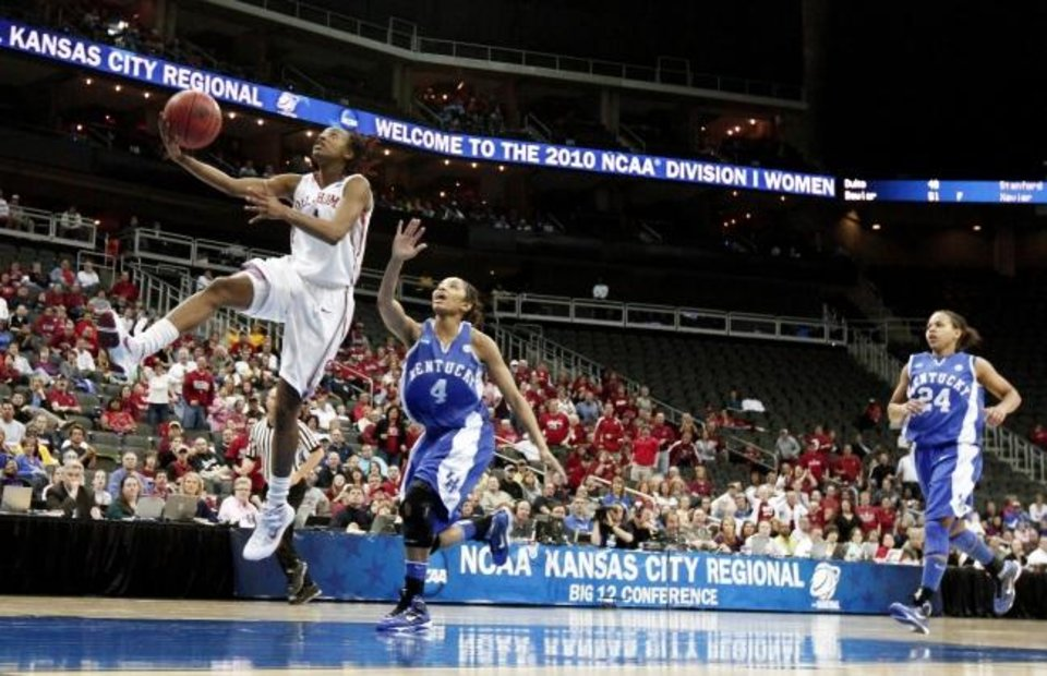 Photo -  OU's Nyeshia Stevenson drives past Kentucky's Keyla Snowden and Amber Smith during the 2010 Elite Eight in Kansas City, Mo., on March 30, 2010. [Bryan Terry/The Oklahoman]