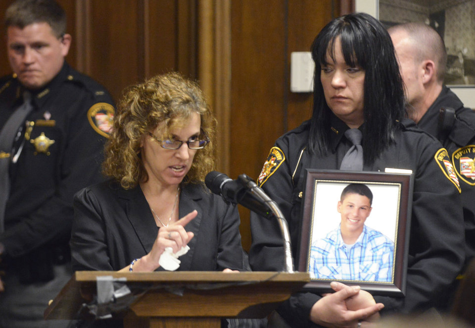 Photo - Dina Parmertor, mother of victim Daniel, speaks during the sentencing of T.J. Lane Tuesday, March 19, 2013, in Chardon, Ohio. Lane, was given three lifetime prison sentences without the possibility of parole Tuesday for opening fire last year in a high school cafeteria in a rampage that left three students dead and three others wounded. Lane, 18, had pleaded guilty last month to shooting at students in February 2012 at Chardon High School, east of Cleveland.  (AP Photo/The News-Herald, Duncan Scott, Pool)